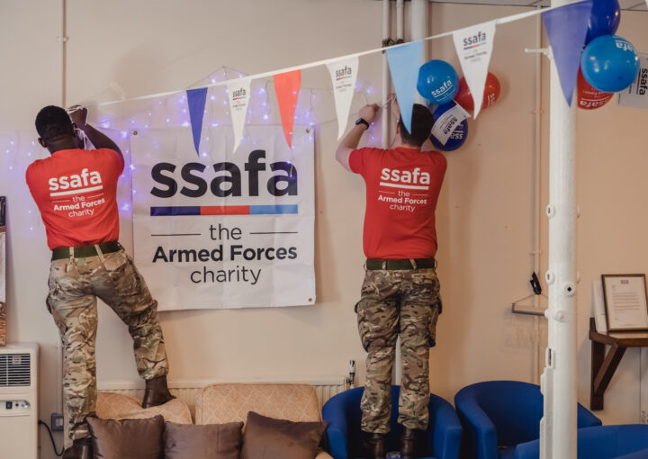 SSAFA supporters hang signs and bunting
