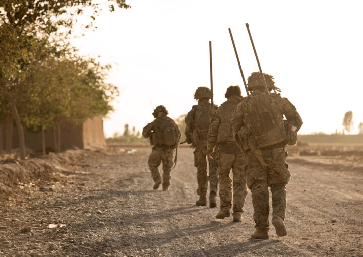 Soldiers walking with rifles