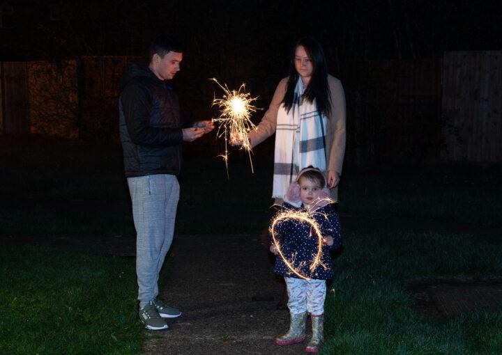 A family enjoys sparklers together